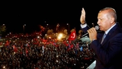 Turkey's Erdogan claims election victory, opposition wary