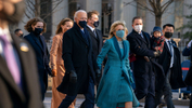 President Joe Biden and First Lady Jill Biden, walk near the White House during a Presidential Escort to the White House, Wednesday, Jan. 20, 2021 in Washington. - AP Photo/Jose Luis Magana