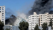 A 12-storey Gaza tower block housing the offices of the U.S.-based Associated Press and Qatar-based broadcaster Al Jazeera collapsed on Saturday after being struck by Israeli missiles.